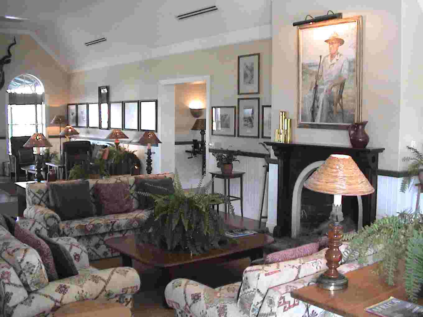 The lounge area and a painting of Harry Kirkman, who was the first director of Kruger National Park.