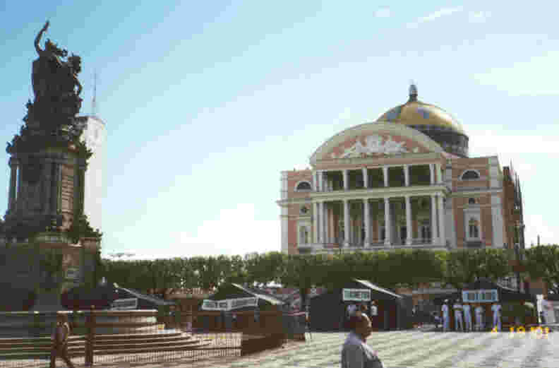 Photo of the famed Manaus Opera House (referred to as the 'Amazon Theater' in our tourist booklet), taken from St. Sebastian's Square, with the Albertura dos Portos monument at left.  Photo by JCG.